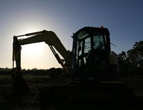 Excavator resting at the end of the day. Royalty Free Stock Photography
