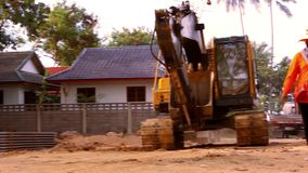Excavator rides in construction site quarry stock footage