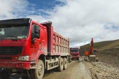 Excavator in road Stock Photography