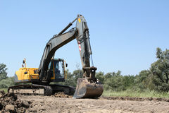 Excavator on road construction Royalty Free Stock Photos