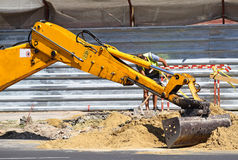 Excavator at the road construction Royalty Free Stock Photo
