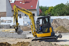 Excavator at the road construction Stock Photo