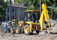 Excavator at the road construction Royalty Free Stock Images