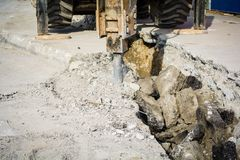 An excavator in a road construction site royalty free stock photography