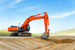 Excavator on road construction Stock Photos
