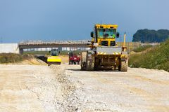 Excavator on a road construction site Stock Images