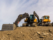 Excavator on a road construction site Royalty Free Stock Photos