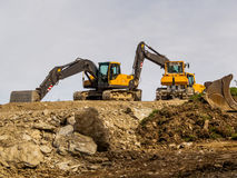 Excavator on a road construction site Stock Image