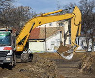 Excavator at the road construction Royalty Free Stock Image