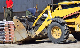 Excavator at the road construction Stock Image