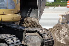 Excavator beside a roadway Stock Photo