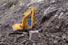 Excavator in the rock mine Royalty Free Stock Photo
