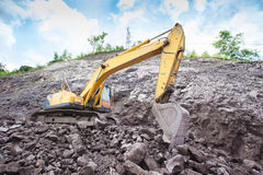 Excavator in the rock mine Stock Image