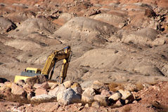 Excavator on a Rock Pile Royalty Free Stock Images