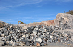 Excavator on rock pile Royalty Free Stock Images