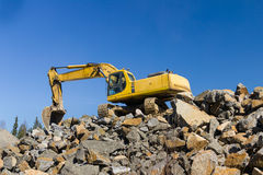Excavator at rock quarry Royalty Free Stock Images