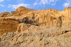 Excavator on the rocks Stock Photo