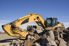 Excavator with rocks Royalty Free Stock Image