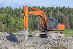 Excavator in rural quarry Stock Photos