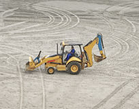 An excavator on the sand. An excavator truck parked on the sand royalty free stock photo
