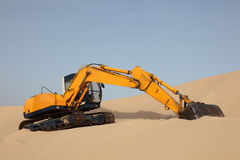 Excavator on a sand dune Royalty Free Stock Photo