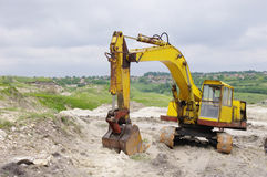 Excavator in sand quarry Royalty Free Stock Image