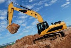 Excavator in sandpit royalty free stock photo