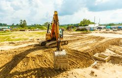 Excavator at sandpit during earthmoving works Stock Photography