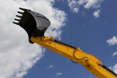 Excavator Scoop. Yellow excavator scoop in cloudy sky Royalty Free Stock Photo