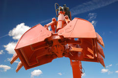 Excavator scoop. Over blue sky Royalty Free Stock Images