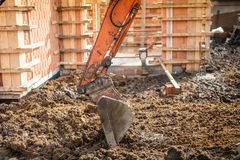 excavator scoop digging earth at construction site Royalty Free Stock Photo