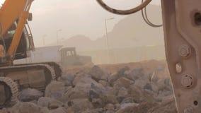 Excavator scoop loads a dump truck. Madina - Saudi Arabia 8 December 2014 - Excavator scoop loads a dump truck stock footage