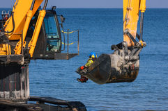EXCAVATOR THE SEA Royalty Free Stock Photography