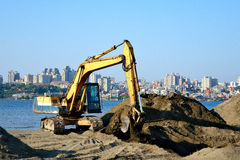 Excavator. On Seaside Construction Site Royalty Free Stock Photography