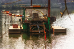 Excavator ship in working order. Dredger, Floating excavator when dredging of soil, sand and silt from a river Stock Images