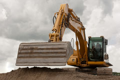 Excavator or shovel. Excavator digging a trench for a new road Royalty Free Stock Photography