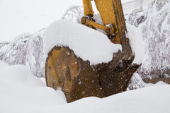 Excavator shovel covered with snow Royalty Free Stock Image