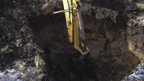 Excavator shovel digging a deep hole. HD stock footage