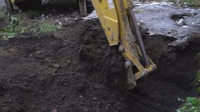 Excavator shovel digs into a ground. HD stock video