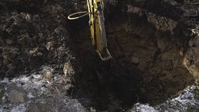 Excavator shovel digs into a ground. HD stock video footage
