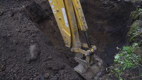 Excavator shovel digs into a ground. HD stock footage