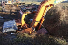 Excavator sinks. Tracked excavator sinks in peat on the somerset levels and moors Stock Image