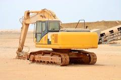 Excavator on site platform. An excavator parking in an industrial site platform Stock Photos