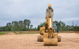 An excavator at a construction job site waiting to be used. stock photo
