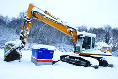 Excavator in snow Royalty Free Stock Photos
