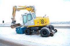 Excavator in snow Stock Photos