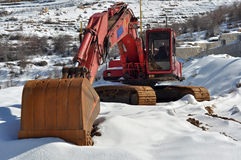 Excavator on snow Royalty Free Stock Images