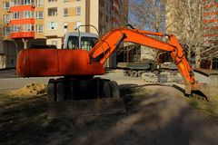 Excavator standing on construction site Stock Photos