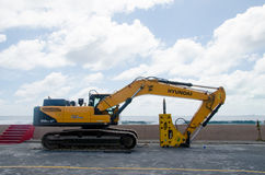 Excavator standing at construction site Royalty Free Stock Photos