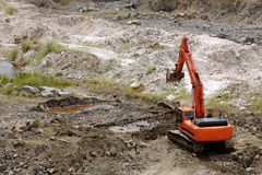 Excavator standing in sandpit Royalty Free Stock Photography